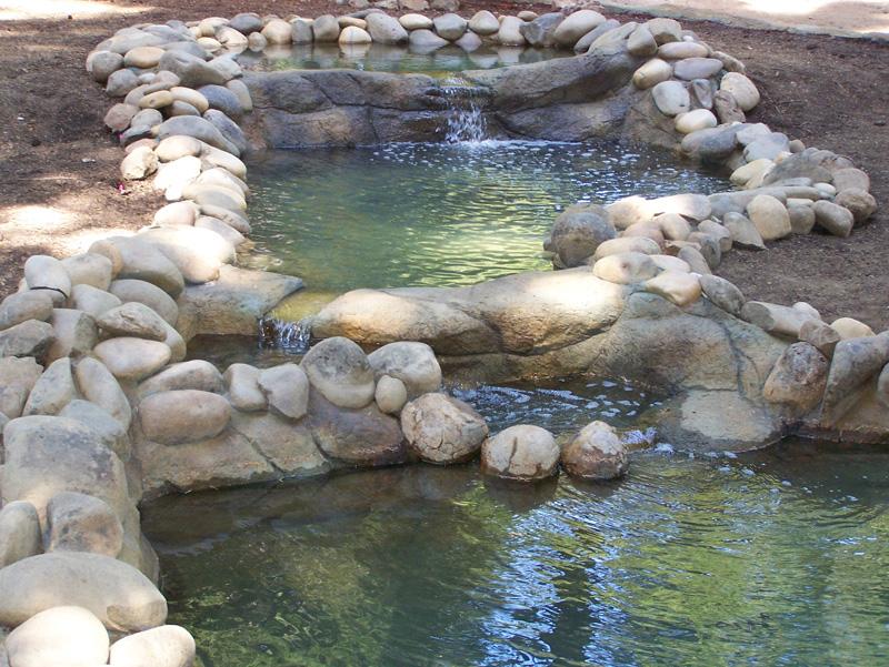 ornimental-pond-and-radius-rock-walls-322